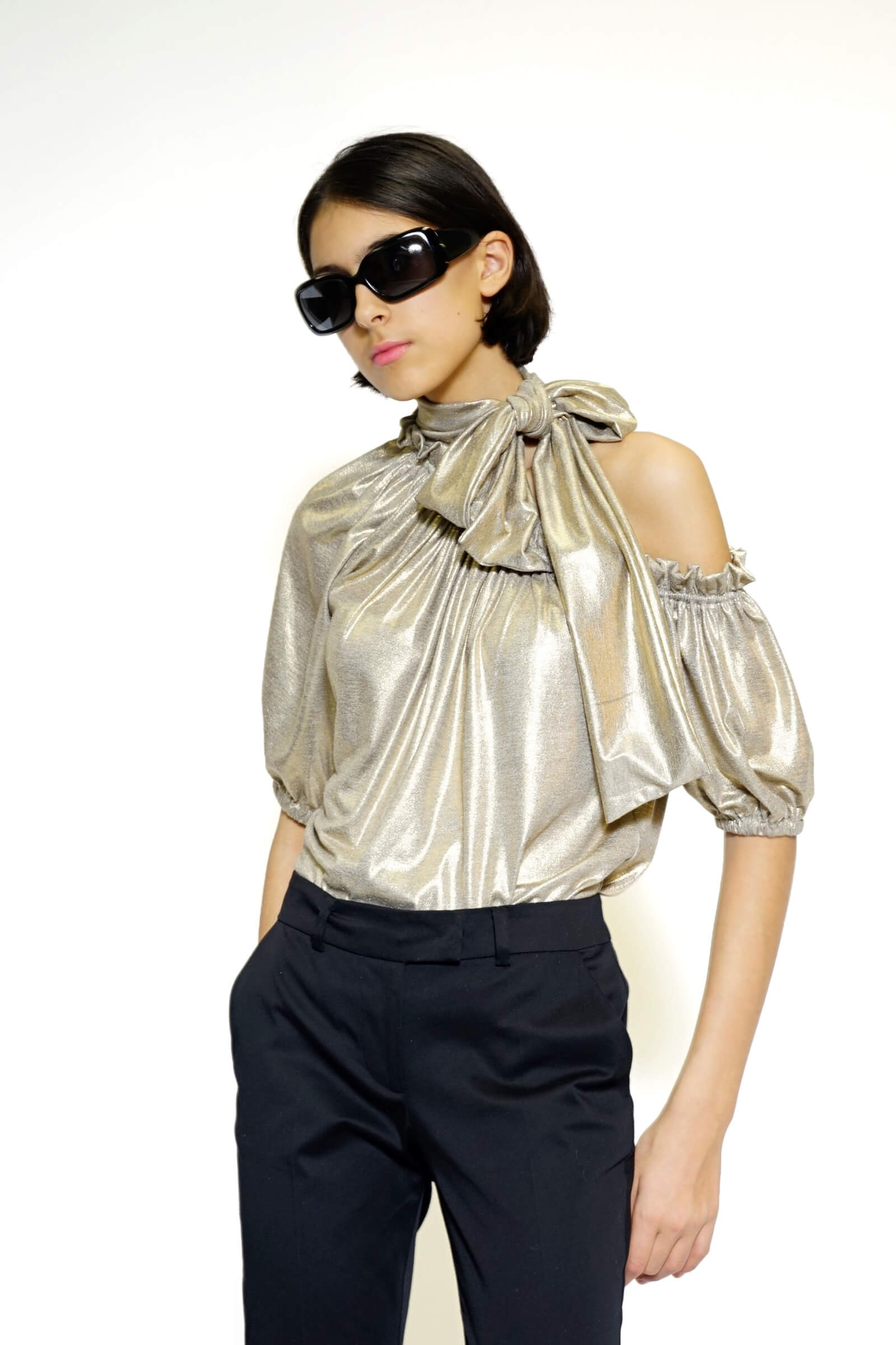 Golden blouse with a bow on...