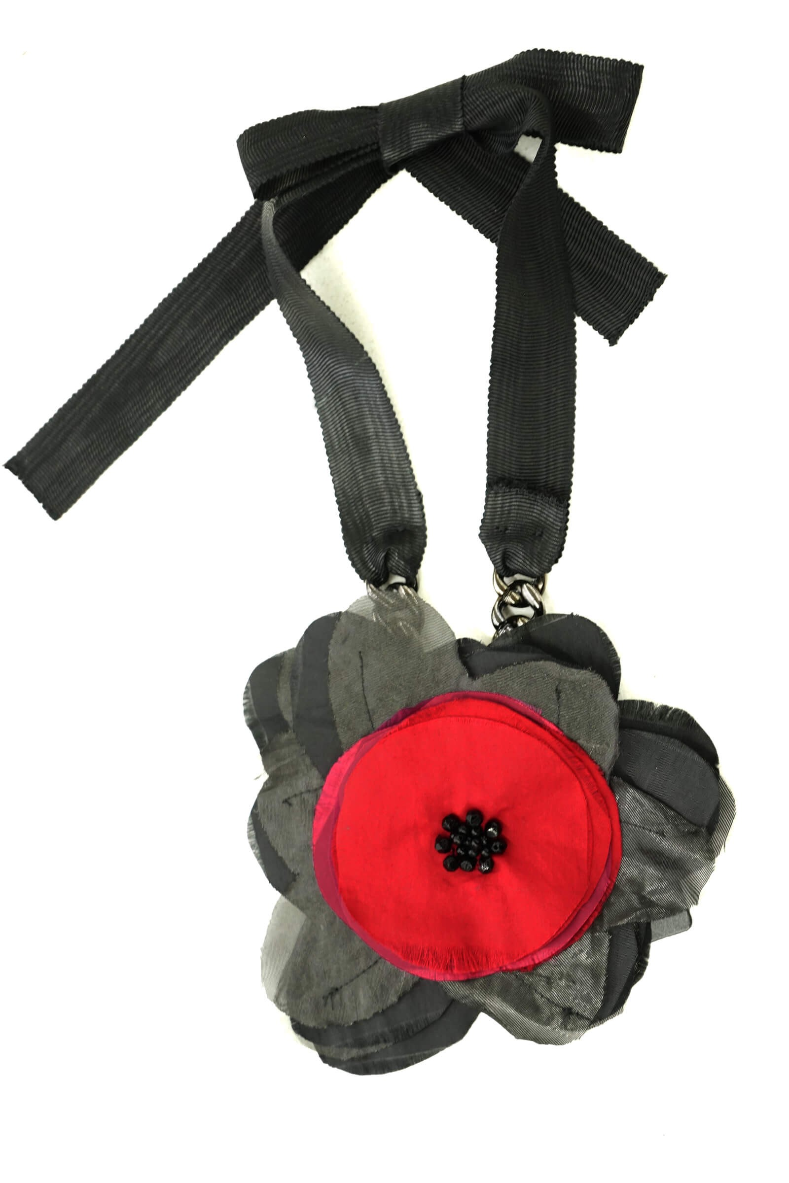 Black necklace with poppy