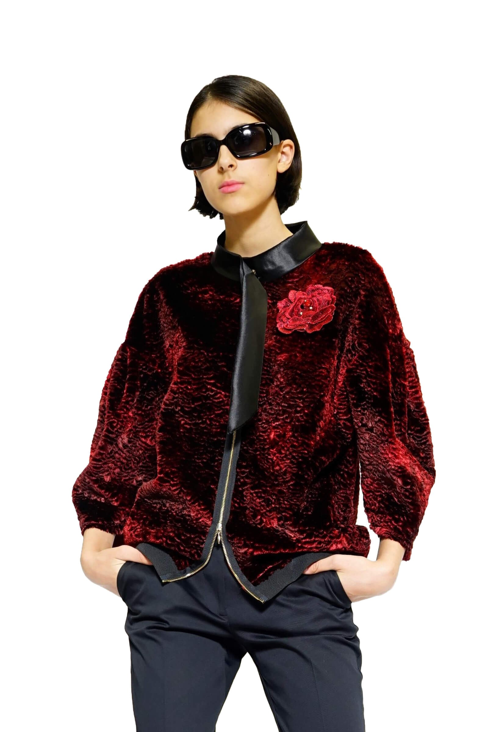 Red jacket with a rose brooch