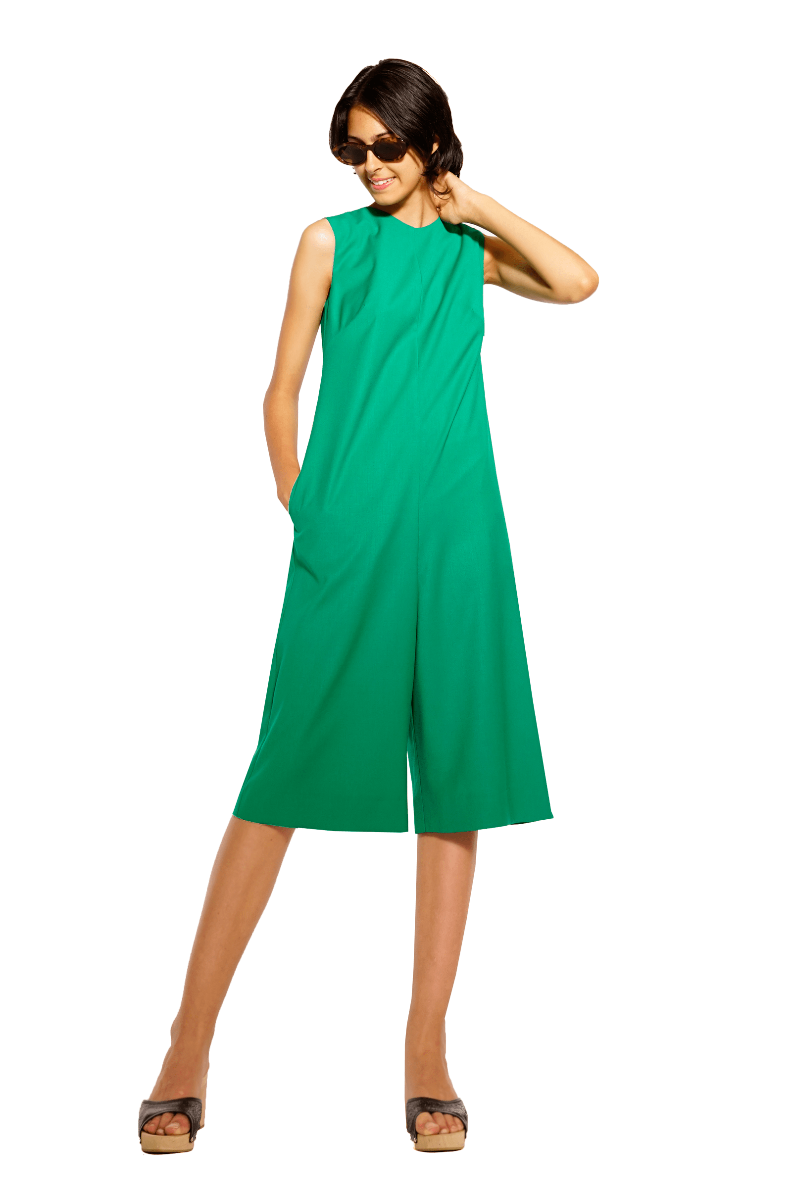 Green jumpsuit cut at the back